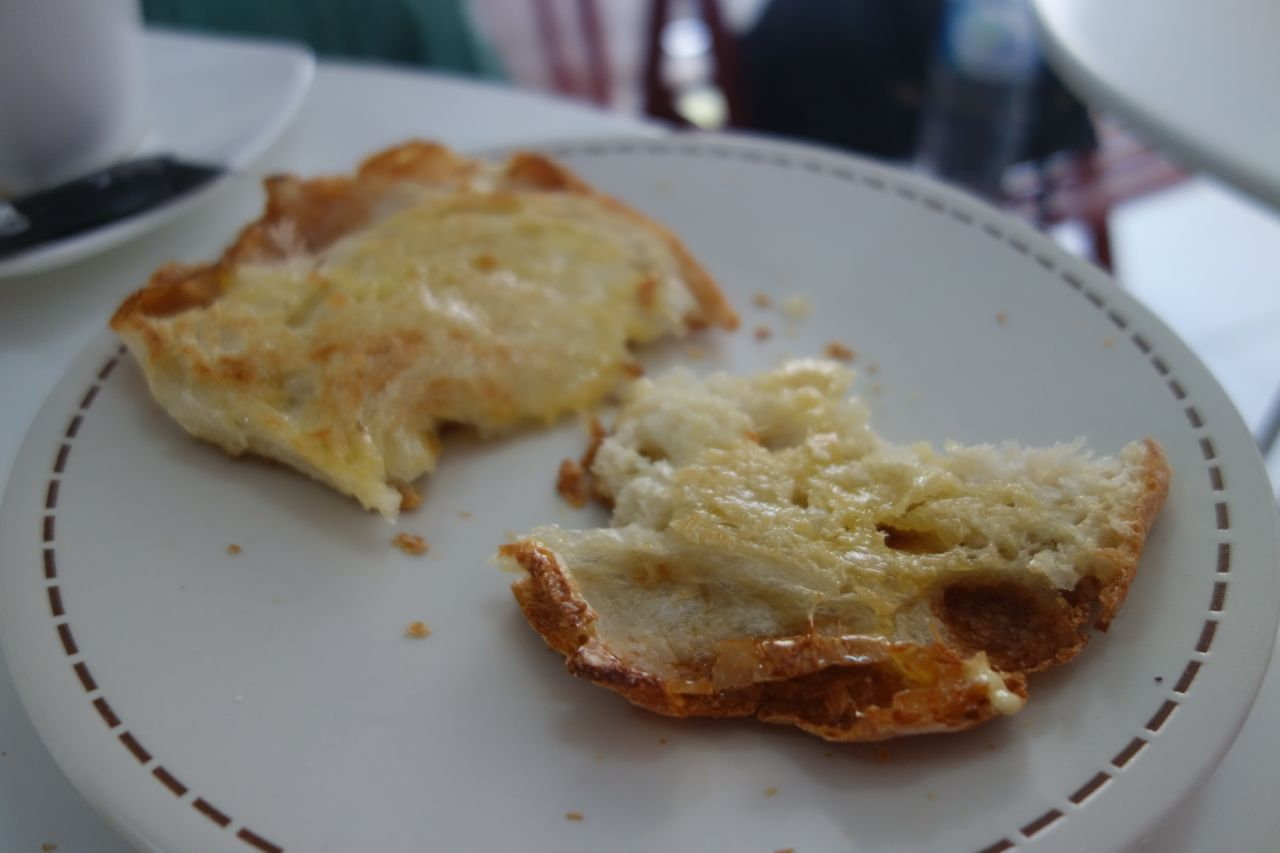 a simple toasted bread with cheese in Padaria Brasao, Dili.